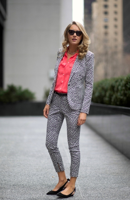With pink shirt and printed suit