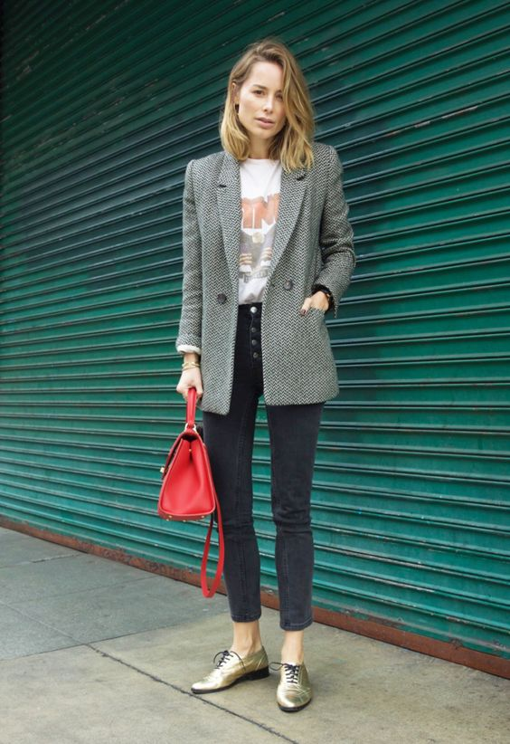 a printed teee, a grey blazer, black cropped skinnies with a row of buttons and metallic shoes