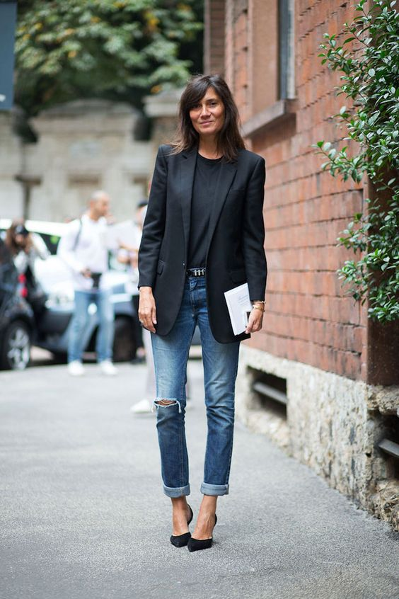 blue ripped boyfriend jeans, black heels, a black top and a black long blazer for a business casual look