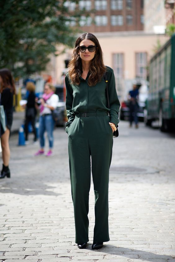 a casual dark green jumpsuit with a belt and black shoes