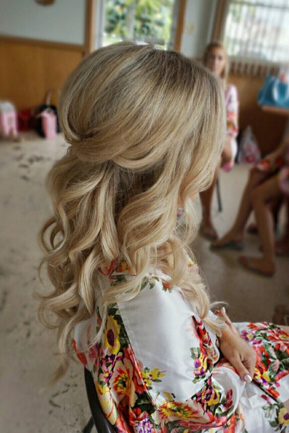 a pretty half up hairstyle with curls and volume on op is a chic idea for any girl