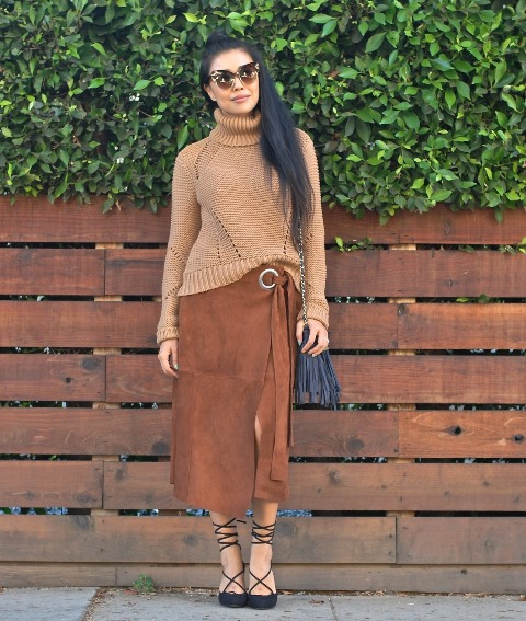 With brown sweater, lace up shoes and fringe bag