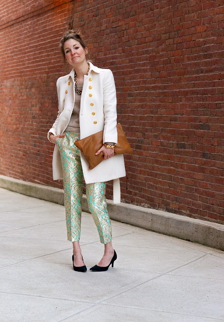 With beige shirt, white coat, black pumps and brown clutch