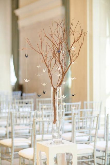 branches with little paper cranes for decorating a contemporary ceremony space