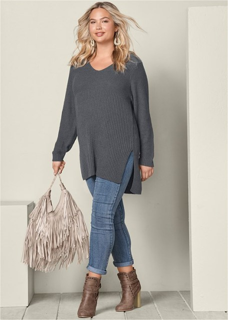 With cuffed jeans, ankle boots and fringe bag