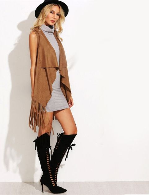 With gray sweater dress, black hat and lace up boots