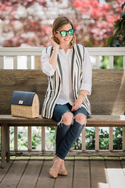 With white loose shirt, jeans, beige pumps and unique bag