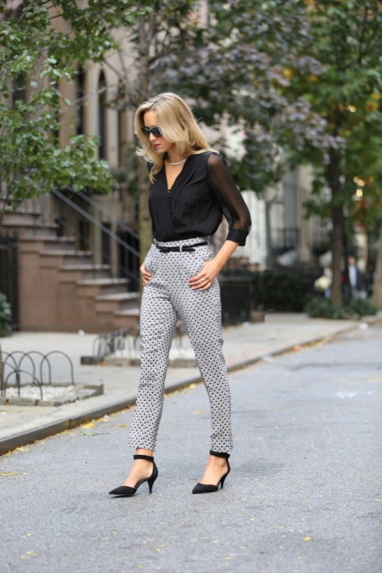 With black blouse, polka dot pants and black belt