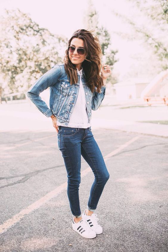 a denim jacket with a white top, denim skinnies and white trainers