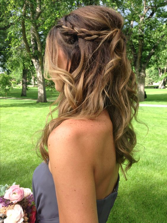 wavy half updo with a braid and volume and with ombre coloring for a more interesting look