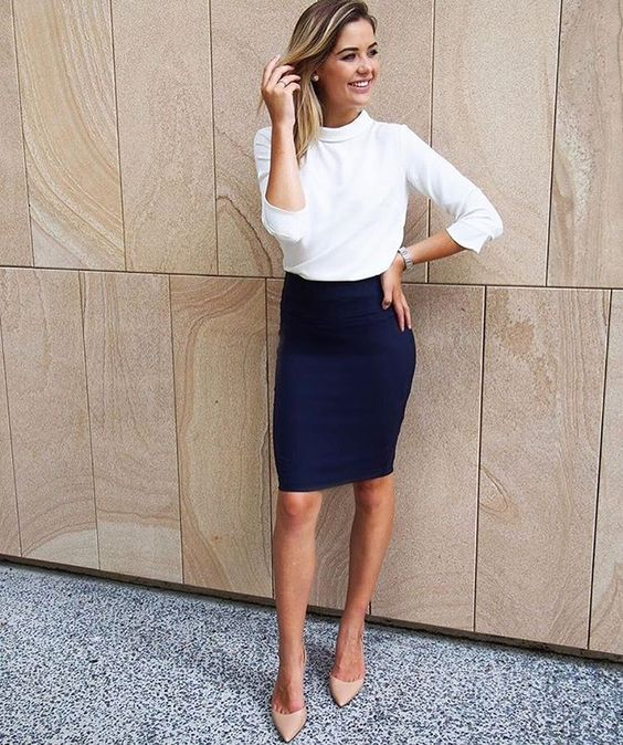 a navy pencil knee skirt, a white turtleneck, nude heels