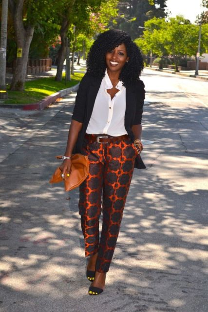 With white shirt, black blazer, orange clutch and heels