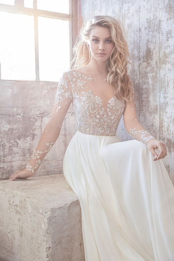 a fantastic illusion bodice wedding dress with an embellished and lace bodice and sleeves and a plain skirt by Hayley Paige