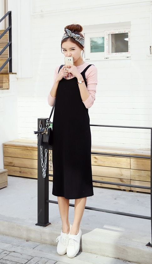 a pink long sleeve, a black overall, white sneakers and a black bag