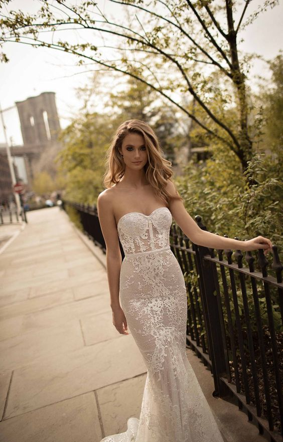 strapless mermaid wedding dress with lace appliques and embellishments for a sexy look by Berta
