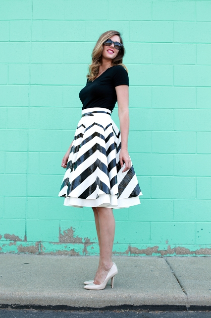 With black shirt and white pumps