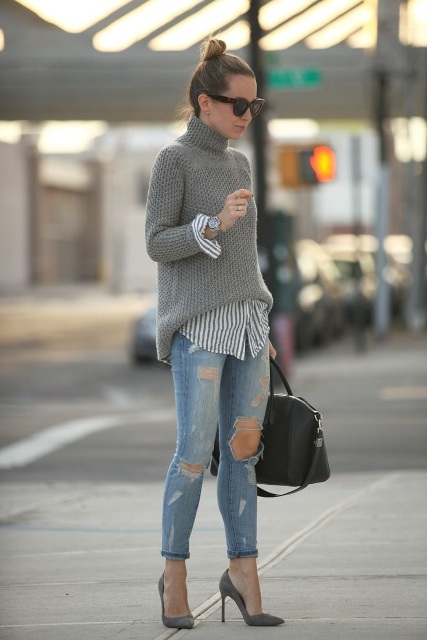 With gray sweater, striped shirt, distressed jeans and black bag