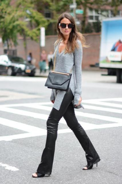With black leather flare pants, heels and chain strap bag