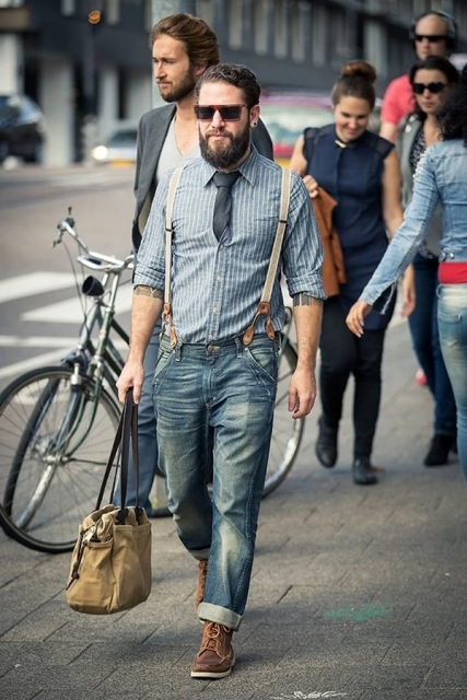 With striped shirt, cuffed jeans, tie, bag and brown boots