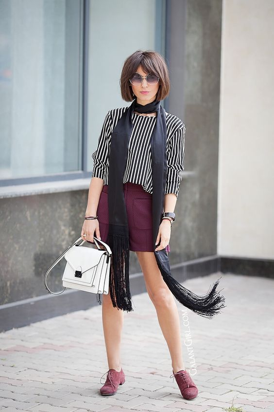a vertical stripe top, a burgundy leather mini with pockets, burgundy suede shoes and a white bag