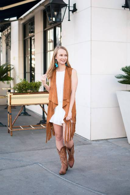 With white dress and cowboy boots
