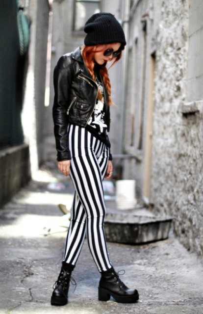 With printed shirt, black leather boots, beanie and leather jacket