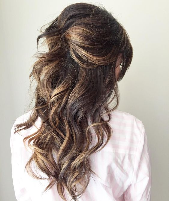 half up sunkissed curlas with twists and some volume on the top