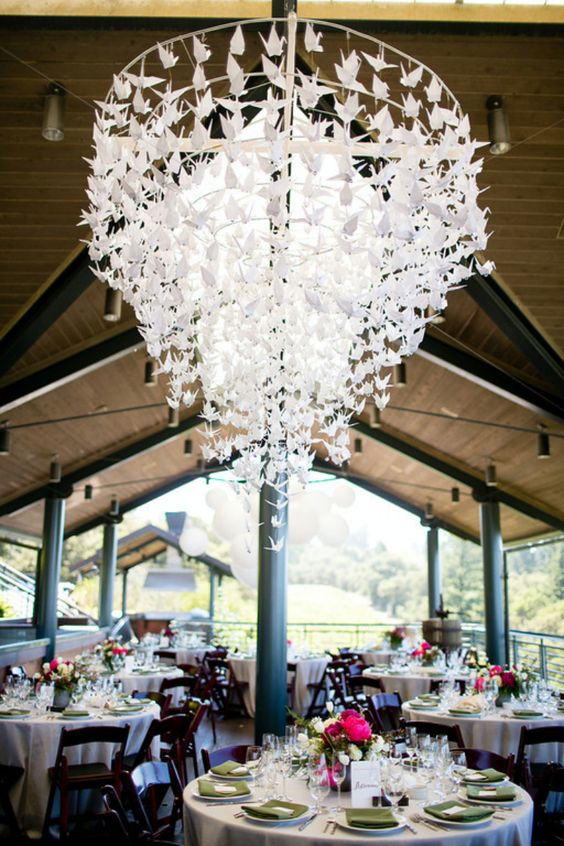 a stunning paper crane chandelier for decorating a wedding venue