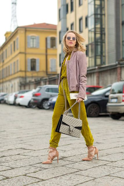 With suede jacket, light brown shoes and printed bag