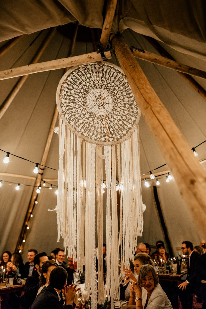 A large dream catcher was hanging in the center of the teepee