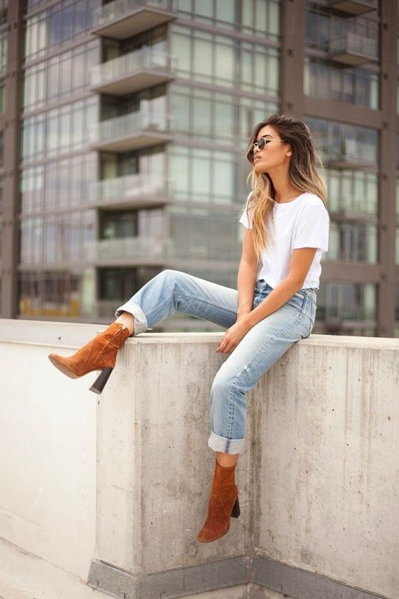 a white tee, distressed cuffed jeans and amber suede booties for a relaxed look