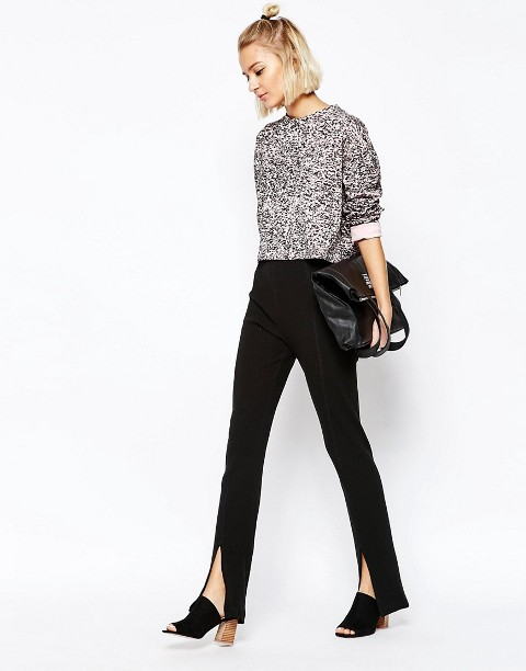 With gray sweatshirt, black mules and leather bag