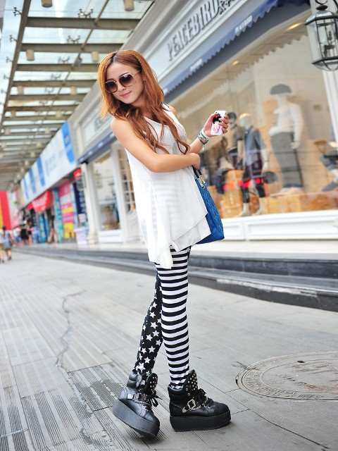 With white blouse, blue bag and platform boots