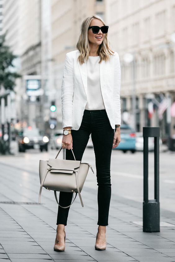 black skinny jeans, a white top, a whwite blazer, nude shoes and a grey bag