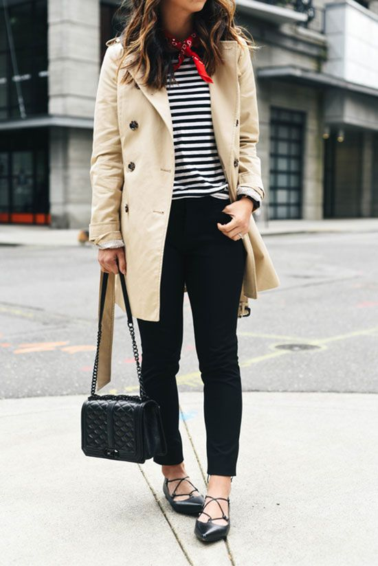 blue skinnies, a black and white striped top, black lacing up shoes, a neutral trench and a black bag