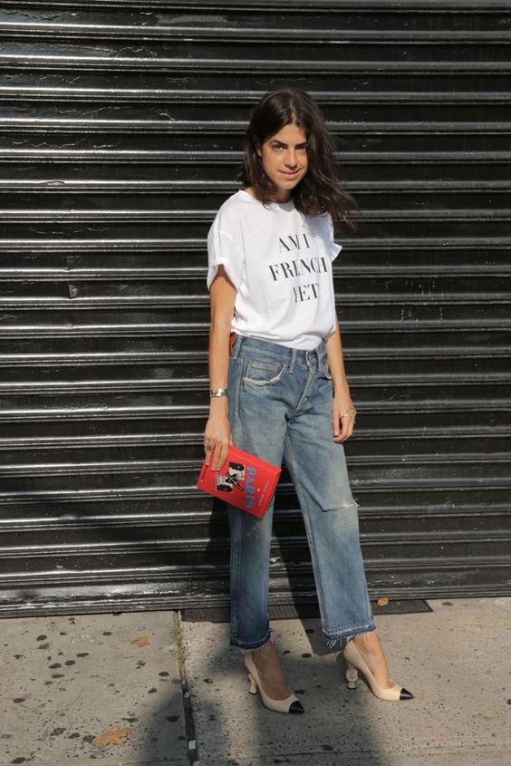 high waisted straight jeans, heels, a printed tee and a clutch
