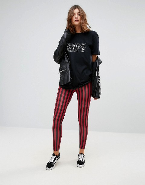 With printed t-shirt, leather jacket and black and white sneakers