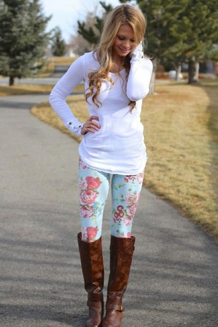 With white shirt and brown leather high boots