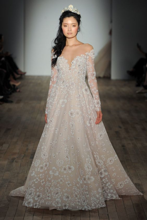 off the shoulder blush wedding dress with long sleeves and white floral lace applqies by Hayley Paige