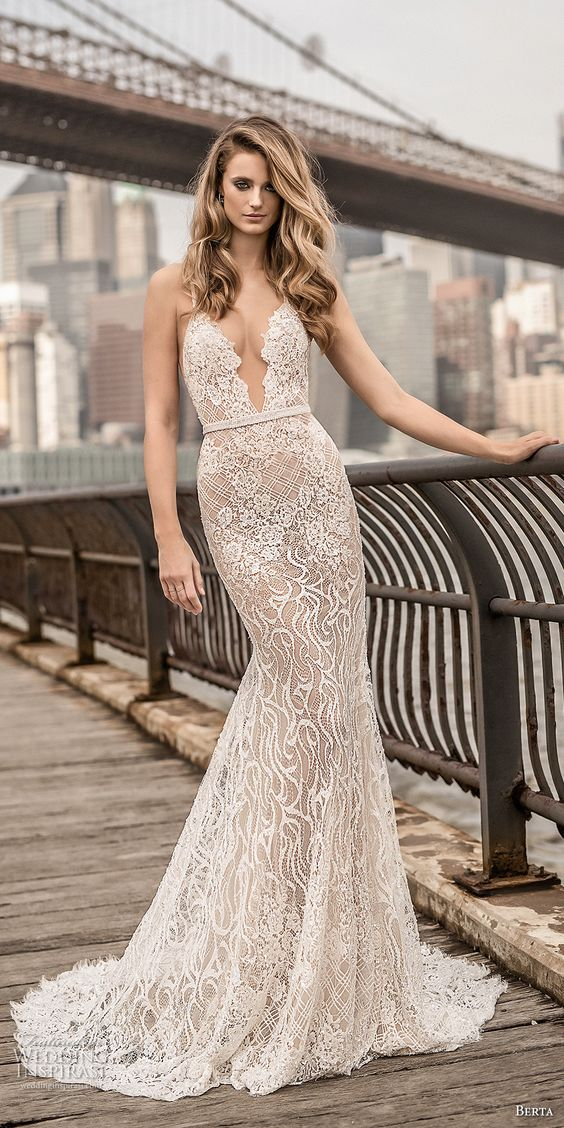 a mermaid spaghetti strap wedding dress with a plunging neckline, embellishments and an open back by Berta Bridals