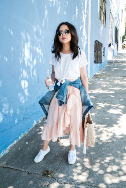 With white t-shirt, white sneakers, denim jacket and tote