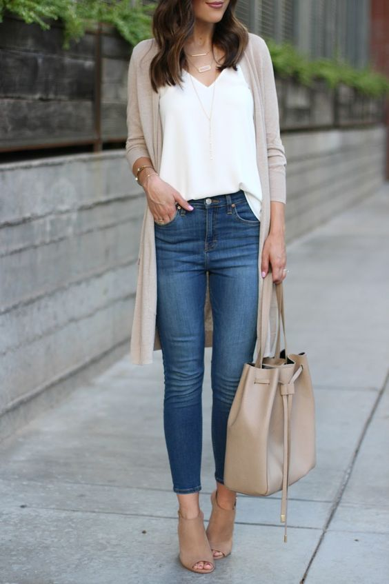 blue jeans, a white top, a tan long cardigan, tan peep toe booties and a matching bag