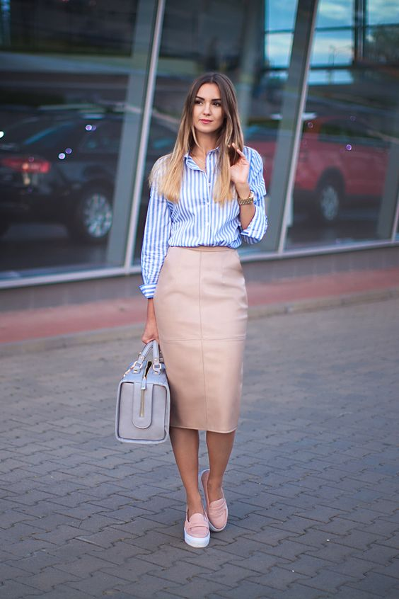 a nude leather midi pencil skirt, a blue and white striped shirt, pink slip-ons and a large bag