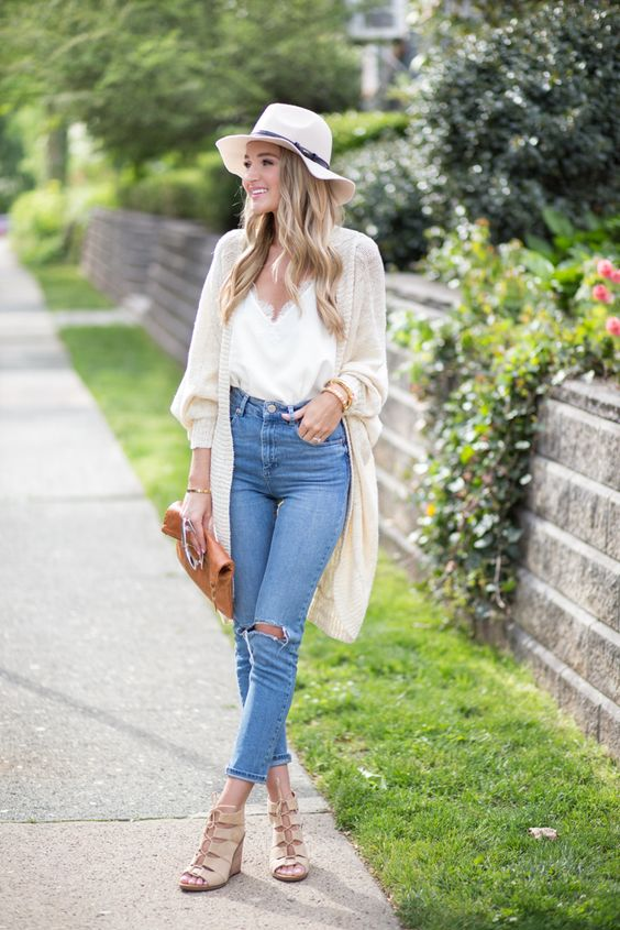 blue ripped jeans, a white top with lace, a light cardigan, nude cutout shoes and a hat