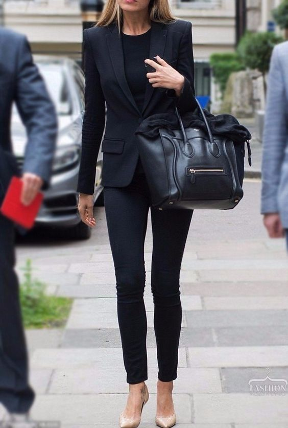 black skinnies, a black top, jacket, bag and nude shoes