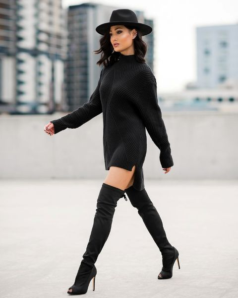 With black over the knee boots and black wide-brim hat