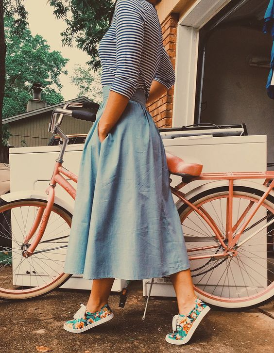 a chambray midi skirt, a striped top with long sleeves and floral sneakers for a relaxed spring look