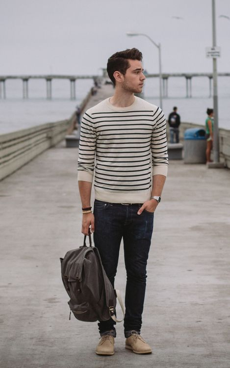 dark denim, beige shoes, a striped top with long sleeves and a backpack