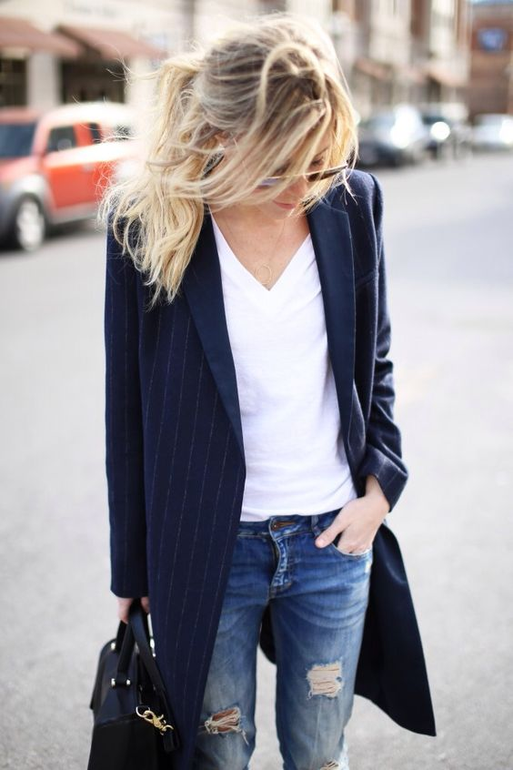 ripped jeans, a white tee, a navy striped long blazer and a black bag for a casual work look