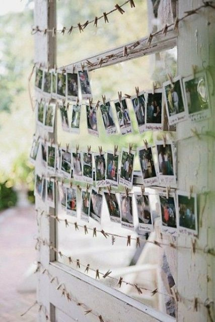 a wedding guest book with Polaroids to write wishes on them